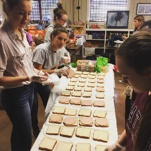 students making lunch for hungry families