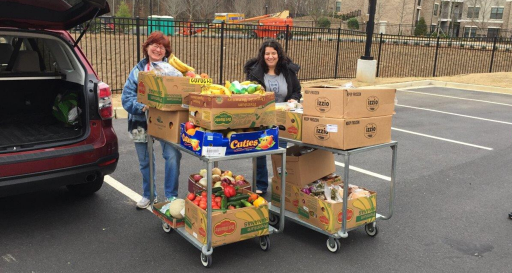 Second Helpings Volunteer, Jeanne Moorman, completes a food rescue at Sprouts with a friend.